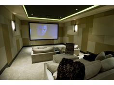 The house on Snug Harbor Road in Newport Beach features a media room.