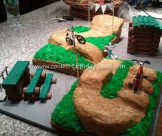Coolest BMX Track Cake: My nephew just turned six. His latest obsession is racing his BMX bike, and he honestly is quite good! He wanted a really cool BMX cake my sister contemplated
