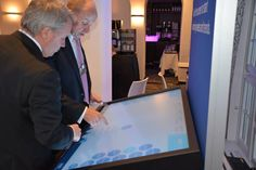 KPMG @ WEF 2015: Mark Goodburn, KPMG Global, and Rob Arning, KPMG US, interacting with the WEFLIVE multi-touch screen in the KPMG lounge at #WEF15.