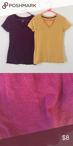 Two v-neck shirts Cute dark plum shirt and mustard yellow. The purple is a as med and has a small hole on bottom, hardly noticeable and the mustard yellow is a size sm. Mossimo Supply Co. Tops Tees - Short Sleeve