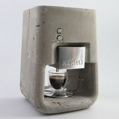 ESPRESSO SOLO - The concrete Lavazza coffe machine designed by Shmuel Linski. The conceptual product features metal working parts and a concrete case.