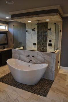 """Gorgeous space-saving tub and shower layout with deep soaking tub in front and walk-in shower behind. Check out the beautiful tile work, recessed lighting, and 3 shower heads in that shower! 