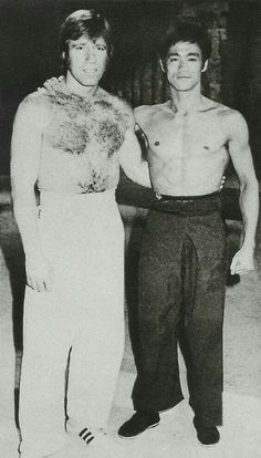 Chuck Norris posing with Bruce Lee