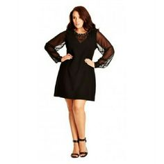 """City Chic Dress Shift Chain NK - Black - 20W / L With a modern femininity and a chain necklace for a sparkling finish, this stunning?plus size dress?walks the line between HR-friendly and night-out-ready attire. This shift dress is roomy enough to make you feel comfortable, yet fitted enough to show off your beautiful figurescoop.  Dress features sheer v-neck/long sleeves and zip back this dress meets you at knee length Dress measures 37"""" long.  polyester/spandex, machine wash.  To complete…"""