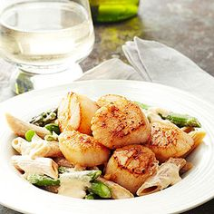 The combination of creamy alfredo, sophisticated scallops, and crisp-tender asparagus make this an elegant dinner option.