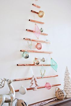 Use copper pipe to create a modern take on the Christmas tree than you can hang up and decorate with your favorite ornaments!