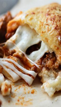 Cheesy Lasagna Calzones ~ They taste just like lasagna in calzone form and take a fraction of the time to cook!