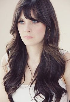 Zooey Deschanel--Has the most beautiful hair. Soft long waves.   Liner on only the top lid. Nude lip.