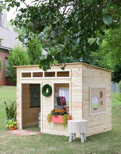 A modern wooden playhouse.