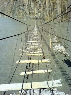 Astonishing Photos of Marvelous Places Around the World (Part - Suspension Rope Bridge, Upper Hunza, Pakistan. Would not try to cross this bridge! Places Around The World, Around The Worlds, Scary Bridges, Rope Bridge, Suspension Bridge, Indiana Jones, Covered Bridges, Land Art, Belle Photo