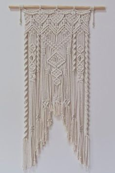 Pocket: Three Thirty Three Wall Hanging is an original modern macrame design by Not Mine Not Yours.