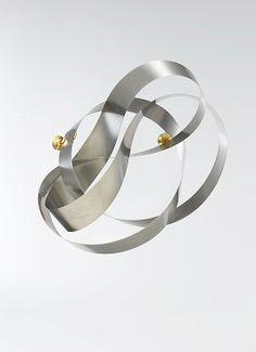 EVA EISLER-CZ mobius brooch, stainless steel, Met collections
