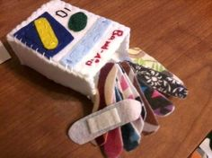 Felt bandaids made with velcro so they can be stuck to stuffed animals.My lil doc will love this!