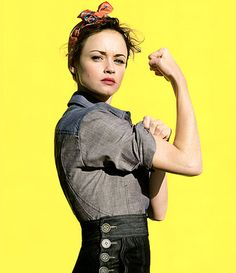 when my son was little, he compared me to Rosie the Riveter.. he said, mom look.  She's just like you.  Strong, hard working, pretty... and look, she wears that same thing in her hair.   :)