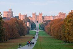 Windsor Castle, viewed from the Long Walk - Favorite residence of Queen Elizabeth II & Prince Philip - It has three Bailey Wards w. central round Keep - made of Bagshot Heath Stone - A Medieval Castle built by Wm. the Conqueror, after Norman Invasion. It Incl. 15th c. St. George's Chapel of English Perpendicular Gothic design.