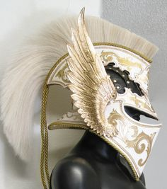 White and gold winged helmet with horsehair crest. Addwean Knight style.