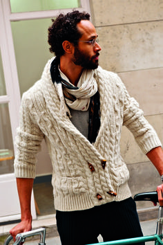 Dress in a nude knit duffle cardigan and black vertical striped trousers for a sharp, fashionable look.   Shop this look on Lookastic: https://lookastic.com/men/looks/beige-duffle-cardigan-grey-crew-neck-t-shirt-black-dress-pants-beige-scarf/6029   — Beige Scarf  — Grey Crew-neck T-shirt  — Beige Knit Duffle Cardigan  — Black Vertical Striped Dress Pants