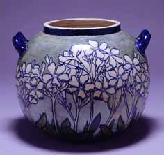 """Two-Handled Vase: """"Phlox""""(c. 1894-1901) The arts and crafts movement inspired the design and decoration of Newcomb pottery, as seen in this piece by Joseph Fortune Meyer, decorated by Gertrude Roberts Smith. New Orleans Museum of Art"""