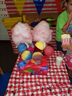 """Pretend cotton candy and snow cones to play with at our """"Cotton Candy Cafe"""" center.  FBC Friendswood Kinder room.  Cotton Candy is made with batting lightly spray painted and hot glued to rolled up butcher paper.  Snow cones are spray painted styrofoam balls hot glued into party hats."""