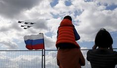 Spectators watch the performance of Sukhoi jet fighters of the Russkiye Vityazi (Russian Knights) aerobatic team during the MAKS International Aviation and Space Salon in Zhukovsky outside Moscow, Russia, August Sukhoi, Political Views, Us Air Force, Fighter Jets, Georgia, Aviation, Military, Moscow Russia, Knights