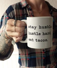 """Need we say more? The """"Hustle Hard"""" 11oz. coffee mug will inspire as well as aid in your caffeine consumption. Aloha Lovely logo branding displayed on other side. This brawny version of ceramic mugs s"""