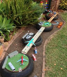 Small World Play. How to build a backyard racing track. Small World Play. How to build a backyard ra Kids Outdoor Play, Outdoor Play Spaces, Kids Play Area, Backyard For Kids, Childrens Play Area Garden, Natural Play Spaces, Outdoor Games, Natural Playground, Backyard Playground