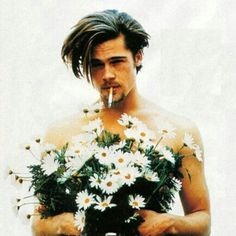 Hot man holding CANNABIS flowers with a joint in his mouth?? (*Props needed: Cannabis flower bouquet)