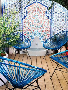 AMAZING blue color! Chairs look like they are MidCent or from CrateandBarrel #OutdoorLiving