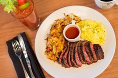 BLOODY MARY STEAK + EGGS grilled flat iron steak, eggs + hashed browns