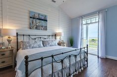 blue and white coastal bedroom with shiplap wall and french doors