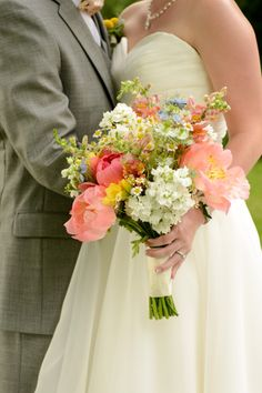wildflower bouquet of coral charm peonies, coral snapdragons, chamomile daisies, white matthiola, blue nigella (www.redpoppyfloral.com)