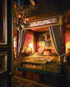 "Tony and Elizabeth Duquette's bedroom at ""Cow Hollow"" had a canopy bed hung with golden Scalamandre silk brocade, amethyst silk gauze and panels of hand painted Chinese silk depicting birds."