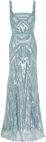 ELIE SAAB  Strappy Full Beaded Gown.  Silver jewelry is a must with this Empire neckline.  Flatters average to larger women with short necks as it offers a balance and makes the neck appear longer.  It does NOT flatter small or petite women as it will draw attention to the less endowed.  Any style and length of necklace will work providing it does not get lost in the cleavage.