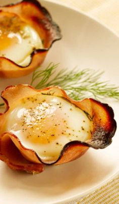 Recipe For Eggs in Maple-​Ham Cups - Maple syrup and fresh herbs infuse the ham cups with flavor. Serve with toast or on a toasted English-muffin half.