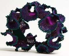 """A bracelet by Sue Von Ohlsen, based on the principles of """"hyperbolic crochet"""" set down in Daina Taimina's """"Crocheting Adventures with Hyperbolic Planes."""""""