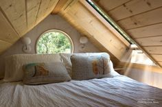 Woman Living Simply in Off Grid Tiny Home on Wheels. This just looks like a lovely place to fall asleep.