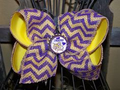 Hey, I found this really awesome Etsy listing at https://www.etsy.com/listing/155063090/big-lsu-burlap-hair-bow-with-bottle-cap