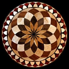 A very popular transitional wood flooring medallion inlay. Shown with Wenge, Maple, Brazilian Cherry, Padauk, Walnut. Colors & size are customizable.