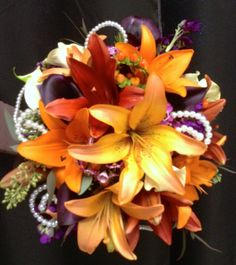 Fall Colors and Pearls Bouquet Created By Flowers By Steen Productions www.flowersbysteen.com