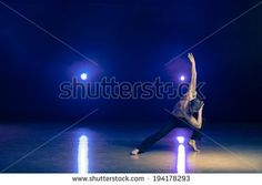 stock-photo-young-and-muscular-man-performing-a-contemporary-dance-pose-on-a-stage-194178293.jpg (450×320)