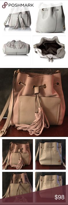 "VINCE CAMUTO ELSIE SUEDE /LEATHER BUCKET BAG GRAY! VINCE CAMUTO ELSIE Suede Leather Drawstring Crossbody Bucket Bag Ghost Gray  *Poshing for my mom OFFERS ACCEPTED!*  Worn 4x? 2 tiny flaws see photos  Adjustable shoulder strap 20-22"" Drawstring closure w/ fringe detail Exterior: suede & leather, hardware logo, one front slip pocket Interior: textile lining; two media wall pockets, one zip wall pocket Original dust bag 9.5"" x 11"" x 2.5""  SMOKE FREE home; we have pets  I package carefully…"
