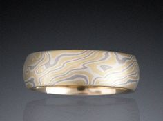 Custom mokume billet of non-etched 18K yellow gold, 14K palladium white gold and sterling silver with 50% 18K yellow gold with 18K yellow gold liner.