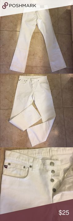 RALPH LAUREN DENIM WHITE JEANS RALPH LAUREN DENIM  by POLO JEANS COMPANY.         5 Pockets Jeans. Button up Front.   Lightly tattered look Style.  Size 8 x 32. 100% Cotton.  Very Cute!!  Please contact me if you have any questions. Ralph Lauren Jeans