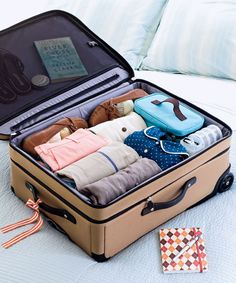 Make a list of the necessities. Minimize wrinkles by rolling, not folding, three to four pieces together, with knits on the inside; for even better results, wrap the bundle in a dry-cleaning bag. And tie a ribbon on your luggage (not solid red — that's what everyone uses), so it's easier to spot at the airport.  - GoodHousekeeping.com