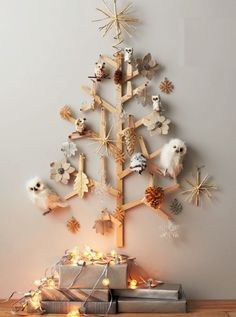 Alternative Christmas tree ideas, tree from wood boards with natural decorations