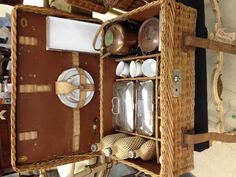 A picnic basket , made in England for Brooks Brothers (complete with tea pot and tiffins)