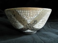 Raku Bowl - White crackle glaze with resist pattern by Pat Joyce (phatcontroller, via Flickr)