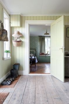 A soft green paint is used in the entry of this country home in Sweden Swedish Cottage, Swedish House, Swedish Farmhouse, Farmhouse Style, Swedish Interiors, Country Interior, Scandinavian Living, House Built, My Dream Home