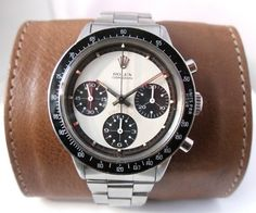The Paul Newman Daytona - next to the Submariner range, this is of the most well-known collectible Rolex watches out there. There is a sort of mythos around the watch given the ambiguous connection to the movie star& culture hero, read more. Dream Watches, Cool Watches, Rolex Watches, Watches For Men, Rolex Paul Newman, Rolex Daytona Paul Newman, Vintage Rolex, Vintage Watches, Tourbillon Watch