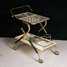 An Early Trolley By Piero Fornasetti. at 1stdibs